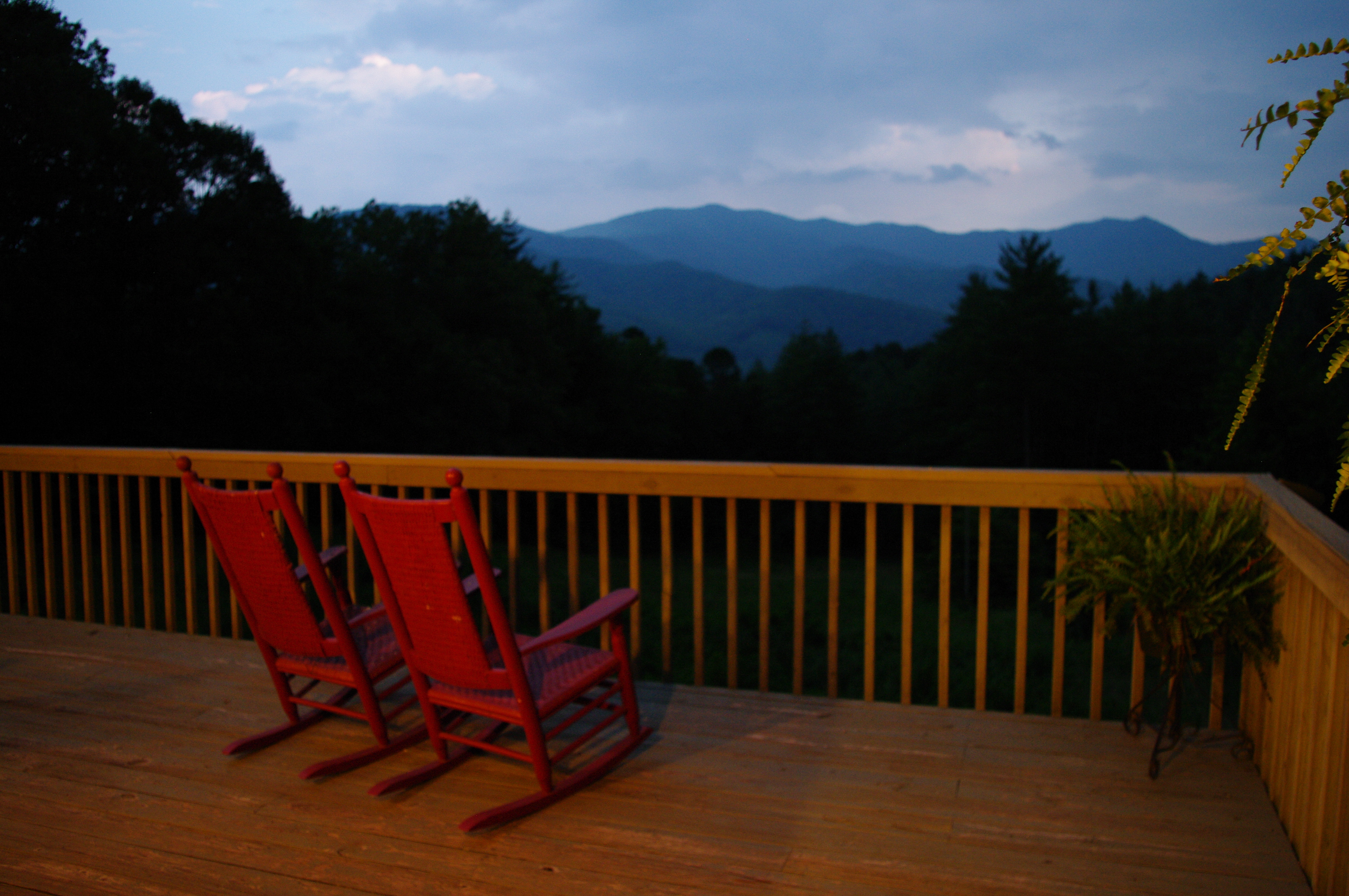 Relax in a rocking chair while overlooking the mountains